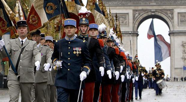 French soldiers parade on the Champs Elysee avenue in Paris as part of Armistice Day ceremonies (AP)