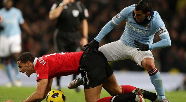 Manchester United's Rio Ferdinand (left) and Manchester City's Carlos Tevez