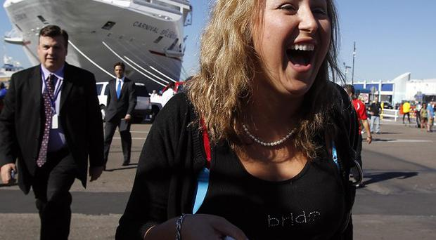 Sabrina Klinge, who was on board the Carnival Splendor for her honeymoon, finally leaves the cruise ship (AP)