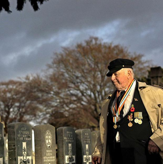 85-year-old Tommy McKenzie from Ballymun, Dublin, who served with the Australian Army, pays his respects at Glasnevin Cemetery