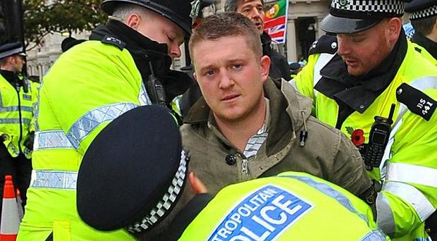 Stephen Lennon is arrested by police at a Remembrance Day protest on Exhibition Road in London