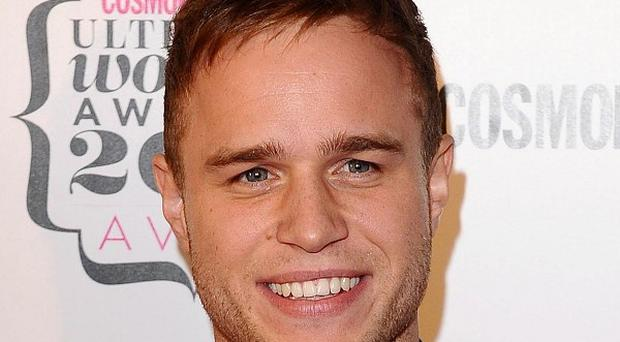 X Factor singer Olly Murs will donate his fee for switching on a town's Christmas lights to charity
