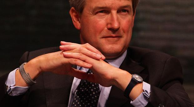 Owen Paterson has backed the end of 50/50 PSNI recruitment