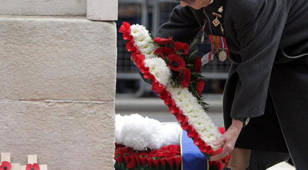 War Widow Hazel Murphy MBE lays a wreath at the War Widows annual Service of Remembrance at The Cenotaph