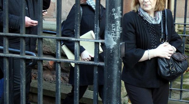 Bar manager Monica Quinn leaves the inquest at Belfast Coroners court