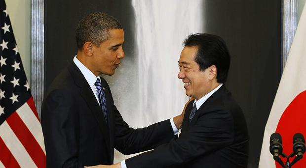 US President Barack Obama, left, shakes hands with Japanese PM Naoto Kan at the APEC summit in Yokohama, Japan (AP)
