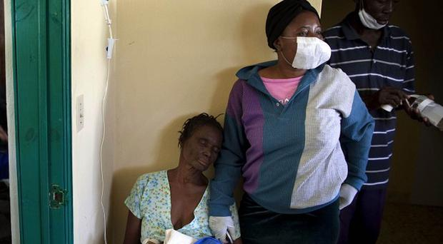 Some of the thousands of patients suffering cholera symptoms in Haiti (AP)