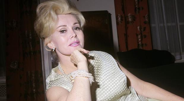 Actress Zsa Zsa Gabor, pictured in London in 1966, is back at home after treatment in hospital