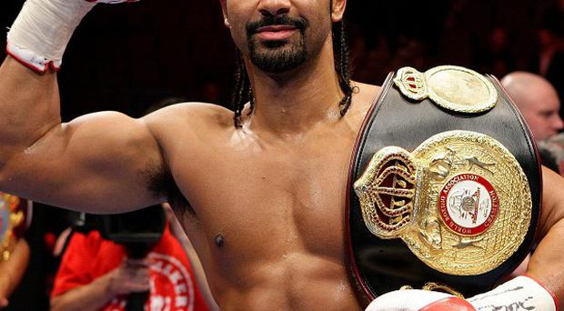 David Haye celebrates with his belt after defeating Audley Harrison