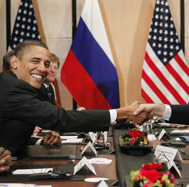 US President Barack Obama shakes hands with his Russian counterpart Dmitry Medvedev (AP)