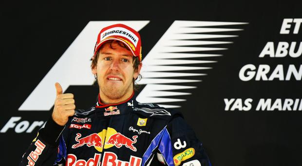 ABU DHABI, UNITED ARAB EMIRATES - NOVEMBER 14: Race winner and F1 2010 World Champion Sebastian Vettel of Germany and Red Bull Racing celebrates on the podium following the Abu Dhabi Formula One Grand Prix at the Yas Marina Circuit on November 14, 2010 in Abu Dhabi, United Arab Emirates. (Photo by Ker Robertson/Getty Images)