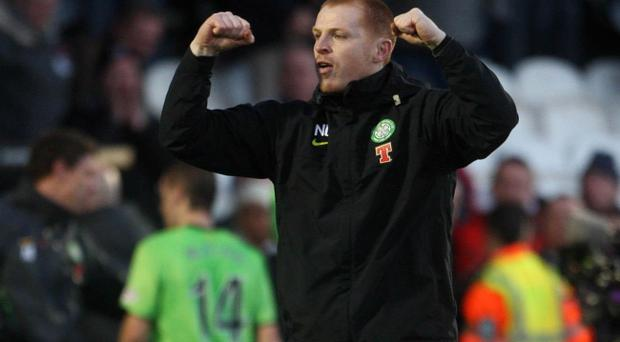 Celtic's manager Neil Lennon celebrates following the Clydesdale Bank Scottish Premier League match at St Mirren Park, Paisley.