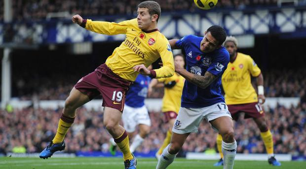 LIVERPOOL, ENGLAND - NOVEMBER 14: Jack Wilshire of Artesenal and Tim Cahill of Everton challenge for the ball during the Barclays Premier League match between Everton and Arsenal at Goodison Park on November 14, 2010 in Liverpool, England. (Photo by Shaun Botterill/Getty Images)