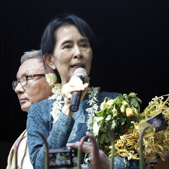 Aung San Suu Kyi delivers a speech to supporters at the headquarters of her National League for Democracy Party on Sunday (AP)