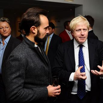 Evgeny Lebedev (left) and Boris Johnson, the newspaper boss has vowed to expose corruption in Russia