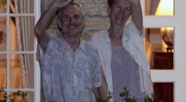Paul and Rachel Chandler wave to well-wishers outside the British High Commission residence in Nairobi, Kenya (AP)