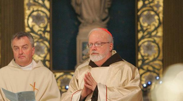 Cardinal Sean O'Malley (centre), from Boston visits St Mary's Pro Cathedral in Dublin
