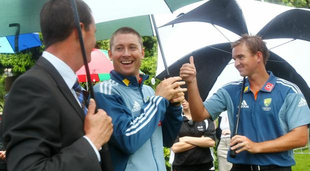 Michael Clarke and Nathan Hauritz wait to go on stage during a press conference to announce the Australian squad