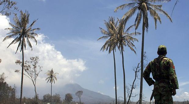 Thousands of residents have returned to damaged homes on the slopes of Mount Merapi, Indonesia