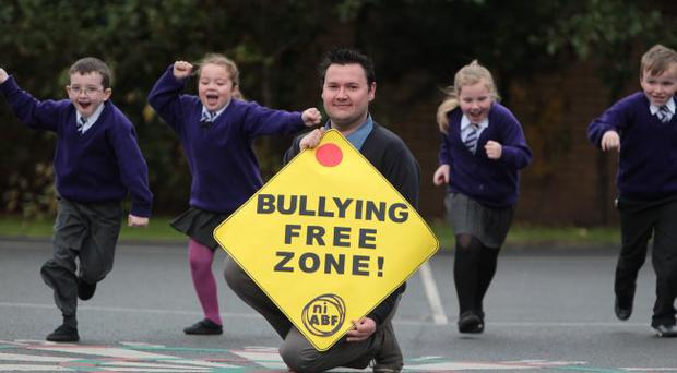 When a bit of banter stops being all that funny Fighting back: Lee Kane, regional co-ordinator with the Northern Ireland Anti-Bullying Forum, with (from left) JJ Johnston (7), Clodagh Byrne (6), Bronagh McCann (7) and Fergal McCann (8) from St Clare's Primary School, Cupar Street, Belfast