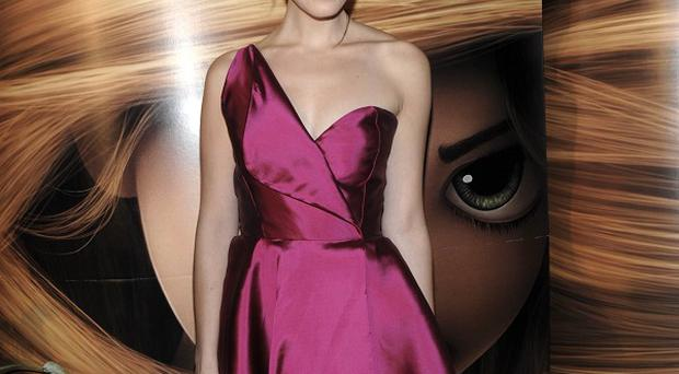 Mandy Moore provides the voice of Rapunzel in Tangled