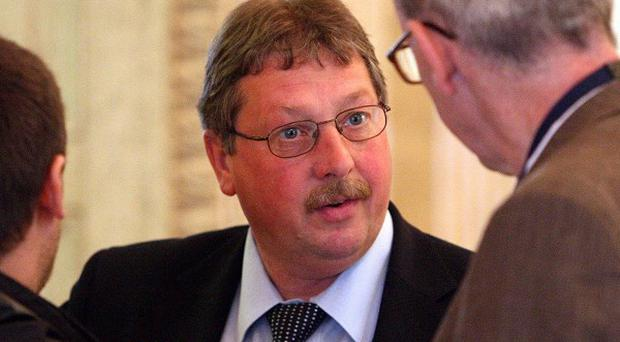 The DUP's Sammy Wilson speaking to journalists in the Great Hall at Stormont
