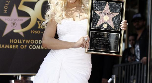 Christina Aguilera after she receiving a star on the Hollywood Walk of Fame (AP)