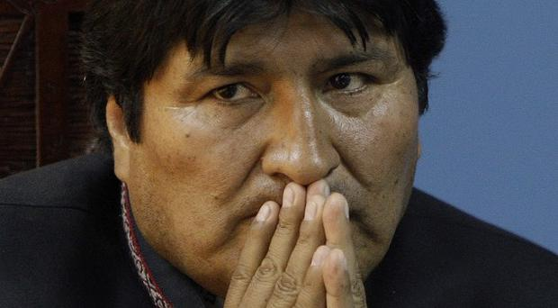 Bolivia's president Evo Morales announced he was nationalising four power companies (AP)