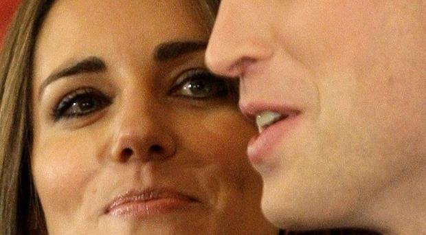 Prince William and Kate Middleton pose for the media at St James's Palace