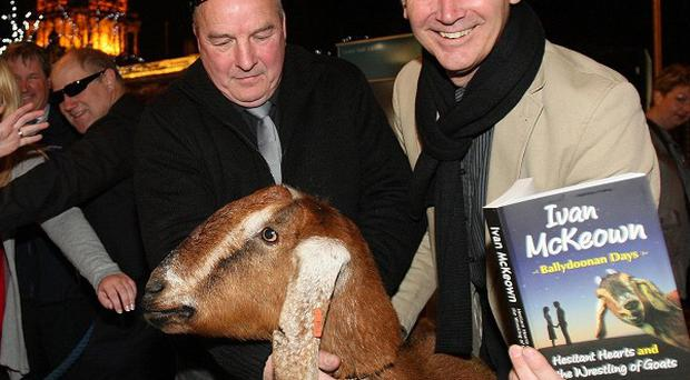 Novelist Ivan McKeown (right) arrives with Gertie the goat at the Linenhall Library