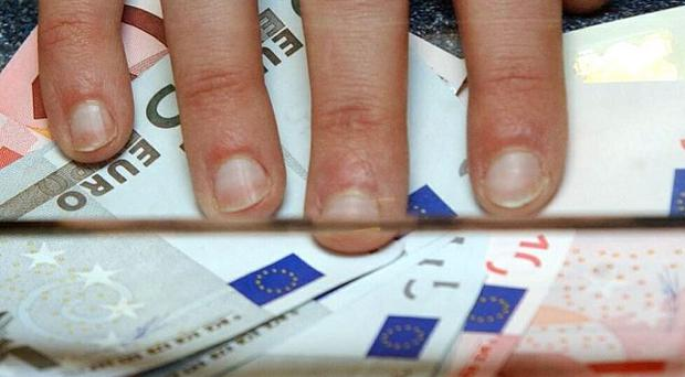 Eurozone nations have agreed to delay the payout of the next instalment of an emergency loan to Greece