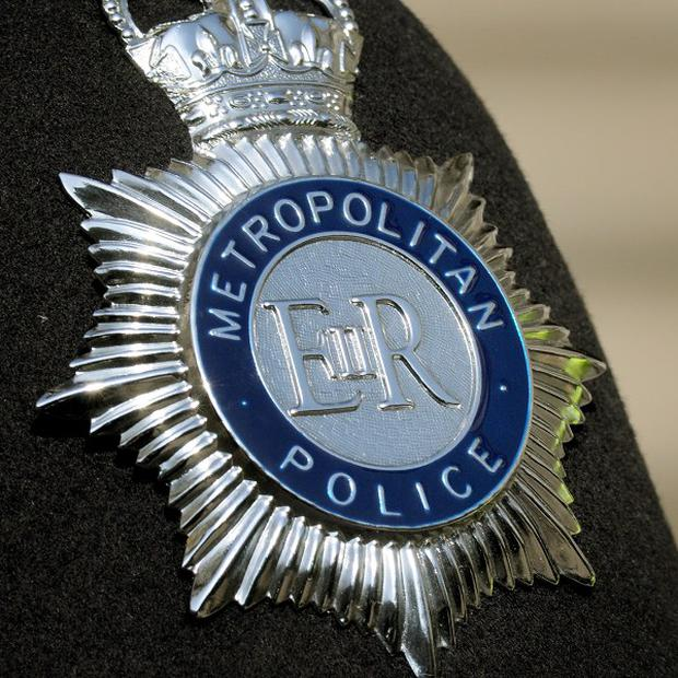 A serving Metropolitan Police officer has been arrested on suspicion of manslaughter, his force said
