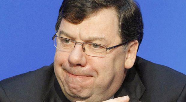 Taoiseach Brian Cowen gives his reaction to the reports on the banking crisis at Government Buildings in Dublin.