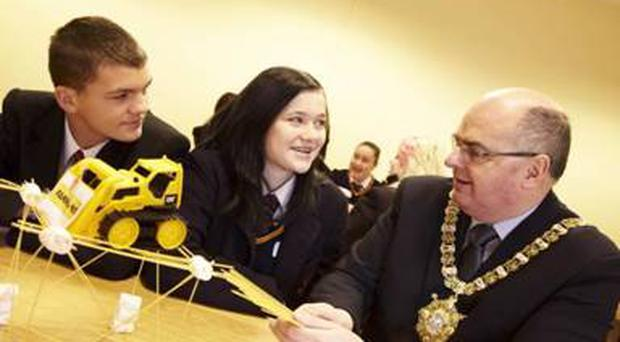 Belfast Lord Mayor, Councillor Pat Convery, helps students from the Boys and Girls Model Schools with their spaghetti and marshmallow challenge