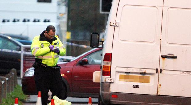 Police officers at the scene on London Road in Sunningdale, Berkshire
