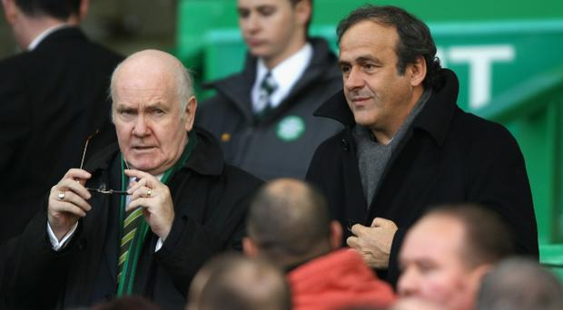 UEFA president Michel Platini and Celtic chairman John Reid during the Clydesdale Bank Premier League match between Celtic and Rangers at Celtic Park on October 24, 2010 in Glasgow, Scotland