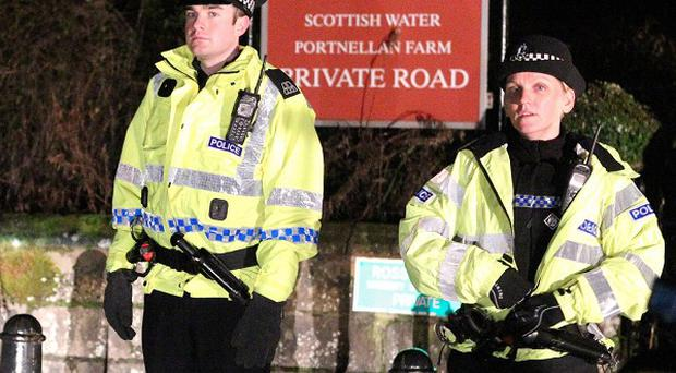 Police stand at the entrance to the Ross Priory at in the Garadhban forest in Gartocharn near Loch Lomond