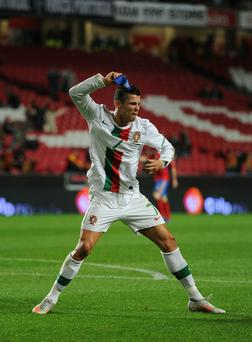 Ronaldo throws down his captain's armband in disgust after the 'goal' was disallowed