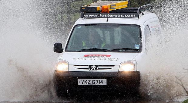 Bad weather has caused flooding on roads across Northern Ireland