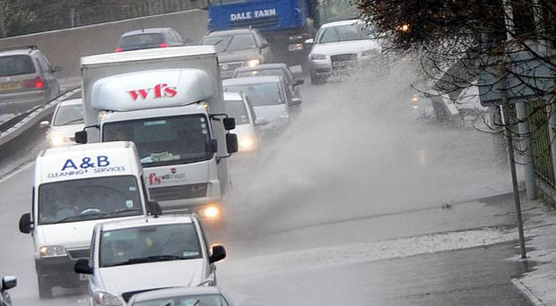 Drivers struggle through puddles on the M3