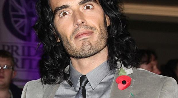 Russell Brand is likely not to face charges over a scuffle with a photographer at Los Angeles International Airport