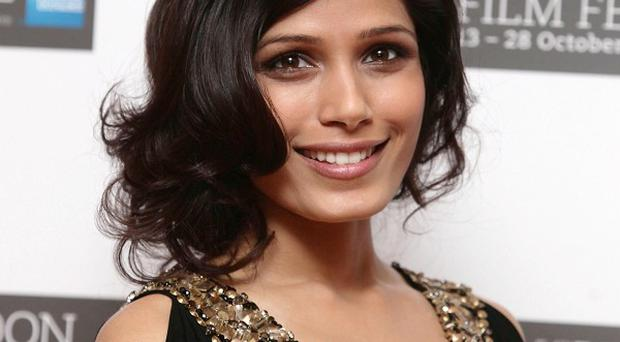 Freida Pinto reckons there was plenty of 'eye candy' on the Immortals set