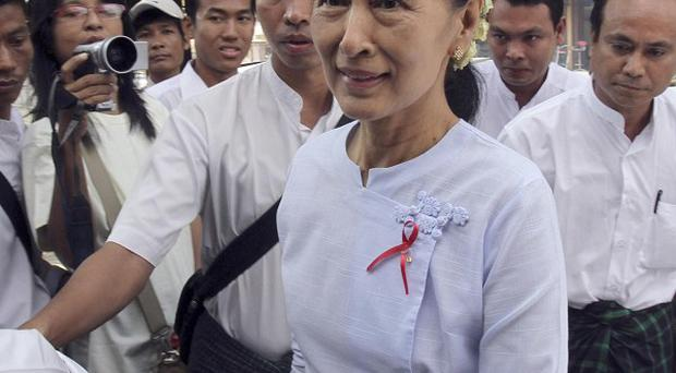 Burma's government ordered more than 80 people at a shelter for HIV patients to leave after a visit by Aung San Suu Kyi