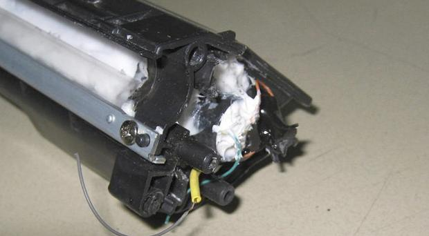 Parts of a computer printer with explosives loaded into its toner cartridge found in a package on a cargo plane