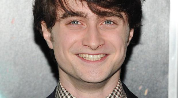 Daniel Radcliffe says it's time to leave the Harry Potter world behind