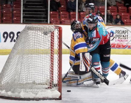 Josh Prudden forces the puck over the line to give the Belfast Giants the lead in Hull last night, but the home side staged a fightback to win the game.