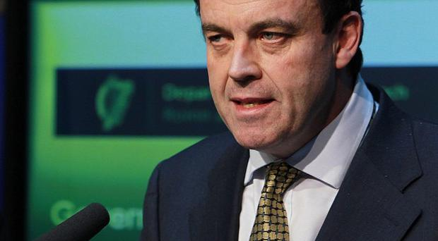 Finance Minster Brian Lenihan after the Government confirmed it will seek a bailout loan