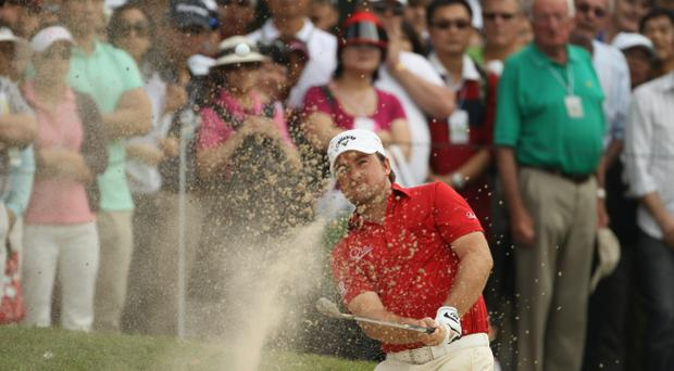 Graeme McDowell gets on the green at the Hong Kong Open
