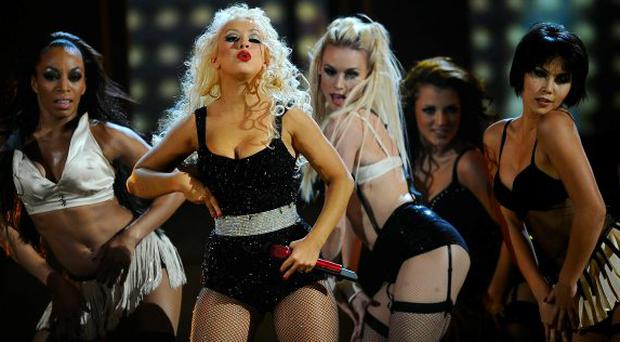 Singer Christina Aguilera performs onstage during the 2010 American Music Awards held at Nokia Theatre L.A. Live on November 21, 2010