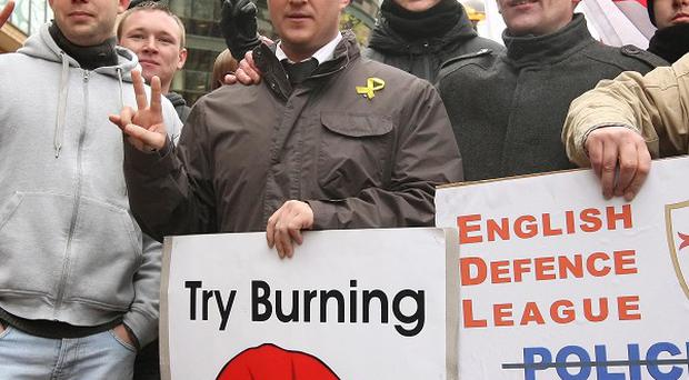 English Defence League founder Stephen Lennon with supporters outside West London Magistrates' Court